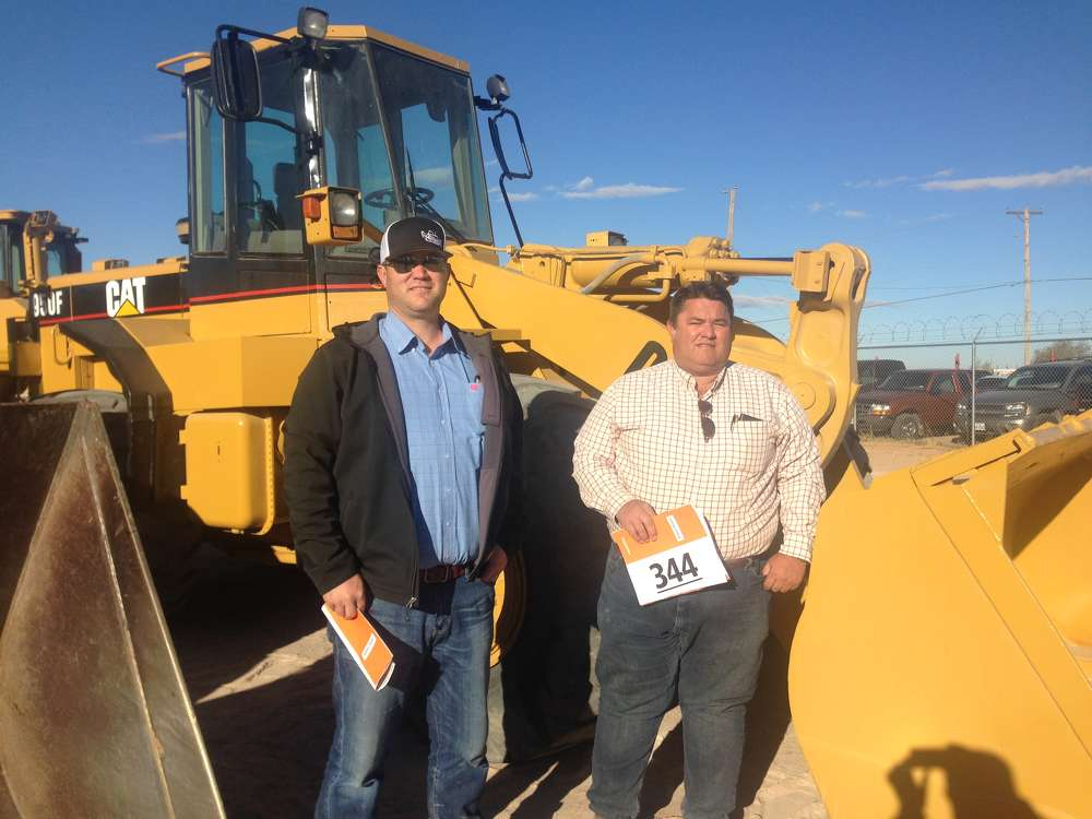 Dallas Jacobsen (L) of Epic Interests and Brian Blanchard of Integrated Machinery traveled from Buckeye, Ariz., to bid on this Cat 950F wheel loader.