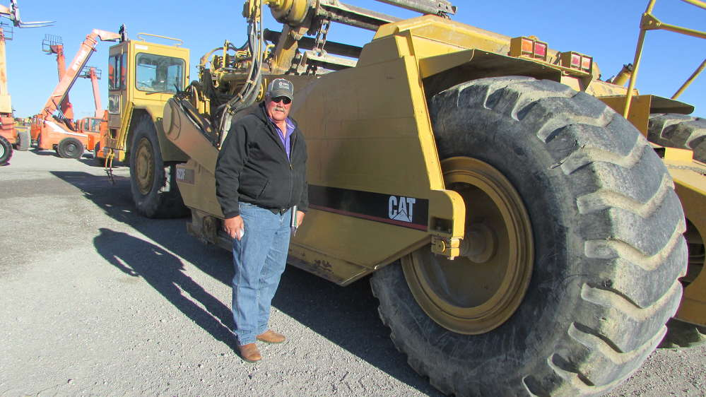 Doug Eichelberger, Eichelberger Farms in Hydro, Okla., thinks this Cat 623F scraper can open some new fields for growing.