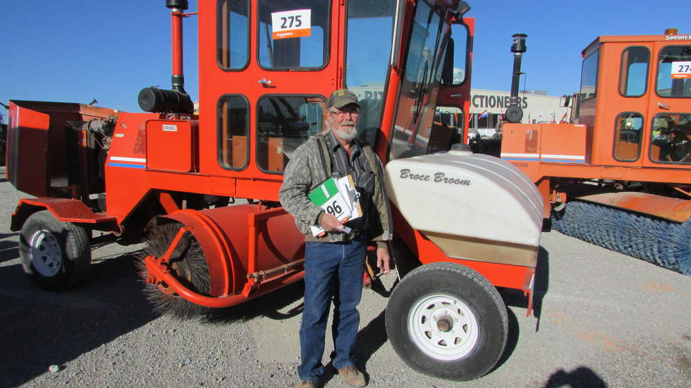 Stewart Spradley with RKM Excavation, Utilities, Structures and Paving, checks out this Broce Broom RJ 350.