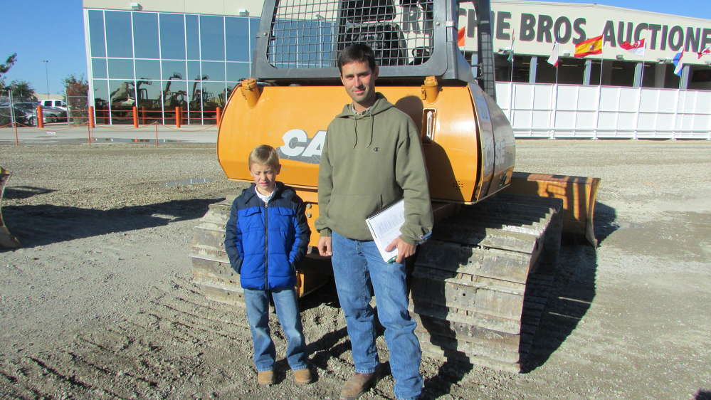 Carson Zimmerman (L) and his dad, Matthew, of Precision Excavating in Wyandotte, Okla., think this Case 650K may go home with them.
