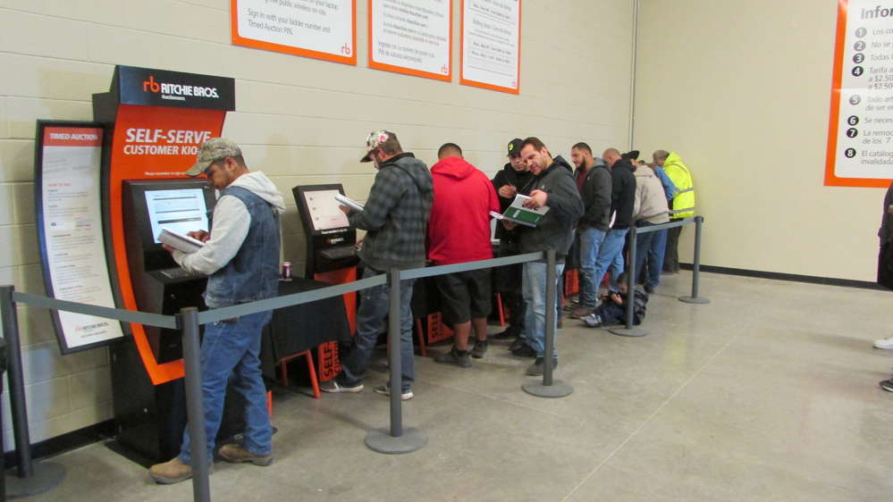 The cold wind drove many folks inside to use the Timed Auction facilities — and many more were lined up waiting.