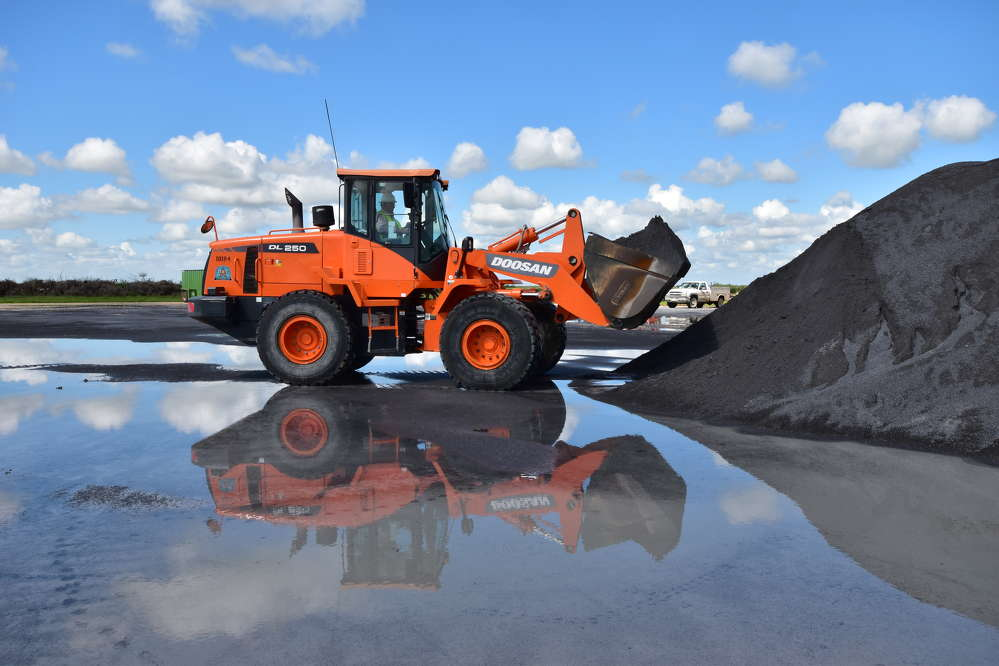 The Doosan DL250-3 wheel loader moved raw materials eight to 15 hours a day, six days a week.
