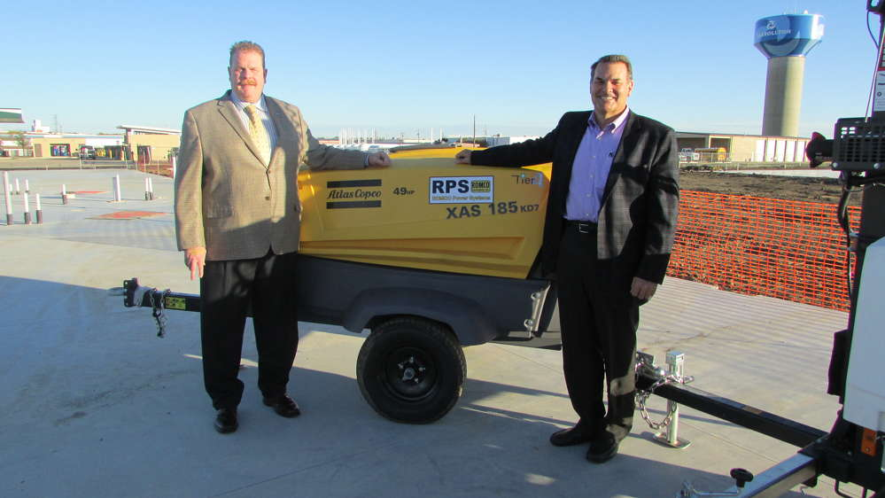 ROMCO's latest product acquisition became official on Nov. 29, when Scott Carnell (L), president of Atlas Copco, Robert Mullins, CEO of ROMCO, met in Carrollton, Texas, to sign the agreement.