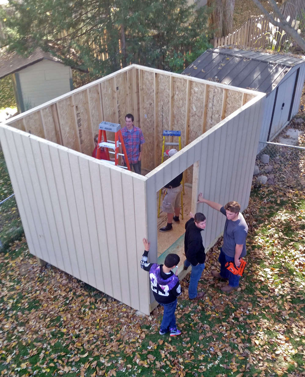 Students in the Ralston High School advanced woods and construction class put up the walls of the shed they built and gave to football coach Jason Fink on Nov. 3. The students built the shed in class in just under two months.