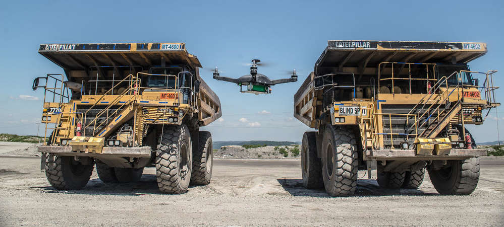 A drone takes off before mapping a construction site using technology developed by Pittsburgh-based Identified Technologies Corporation.