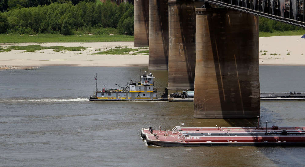Two barges carefully pass each other on the Mississippi River.