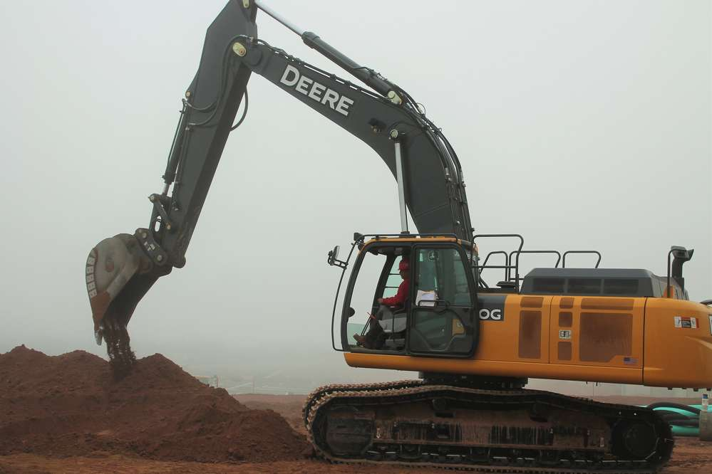The John Deere 380G excavator, part of the Pierce Builders' fleet, works to complete one of the largest dairy farm expansions in the history of Connecticut.