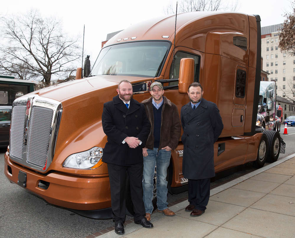 Three finalists in the Transition Trucking: Driving for Excellence recognition program stand with the Kenworth T680 that was awarded to the program's top rookie military driver. From left are Troy Davidson, a driver with Werner Enterprises and the recipient of the top honor; Kevin Scott, a driver with TMC Transportation; and Russell Hardy, a driver with Trimac Transportation.
