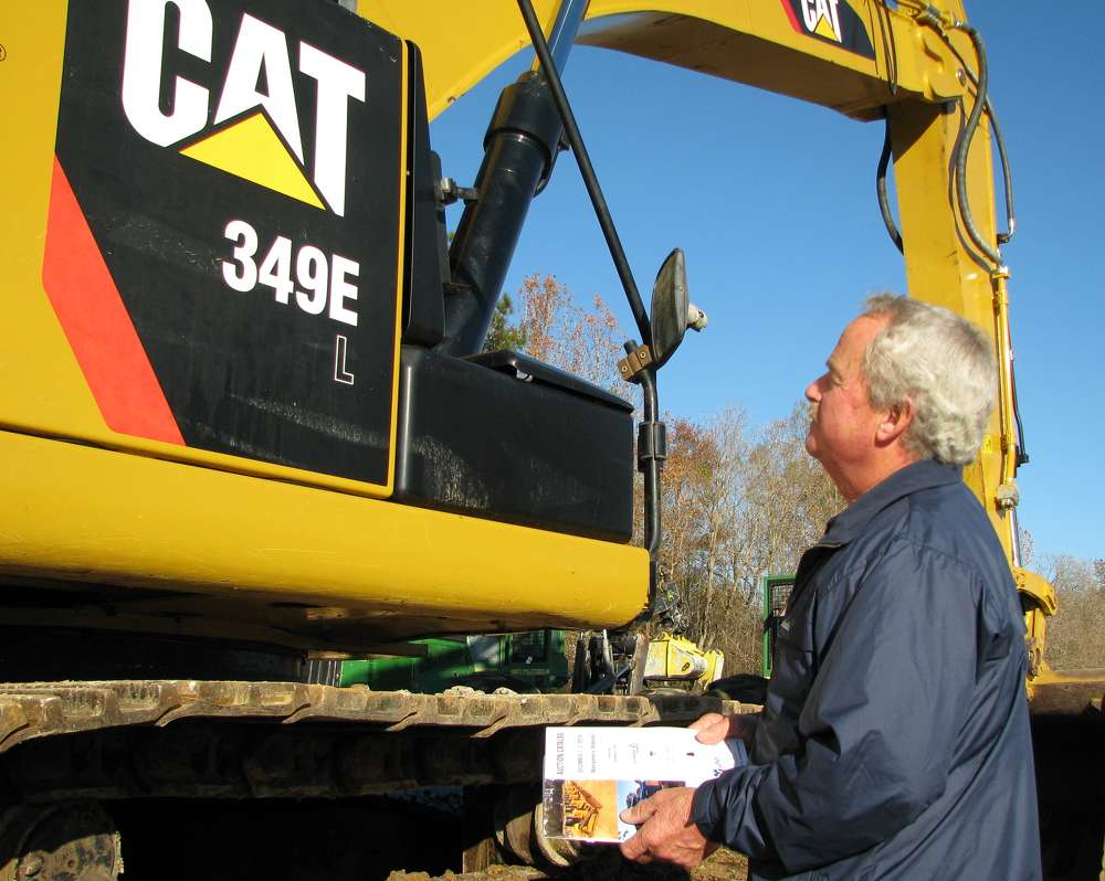 Michael Goodson of Goodson Construction, Aynor, S.C., assesses this Cat 349EL.