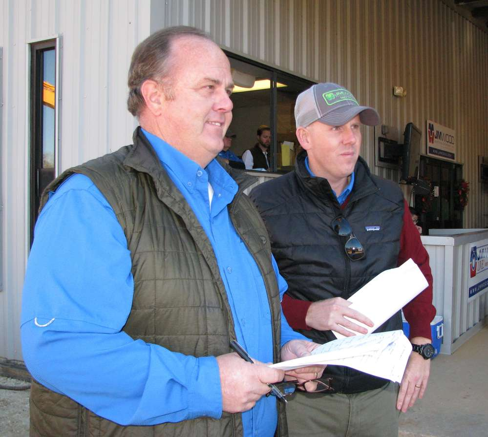 Bryant Wood (L), JM Wood president, and Russ Wood, JM Wood, keep the auction running smoothly.