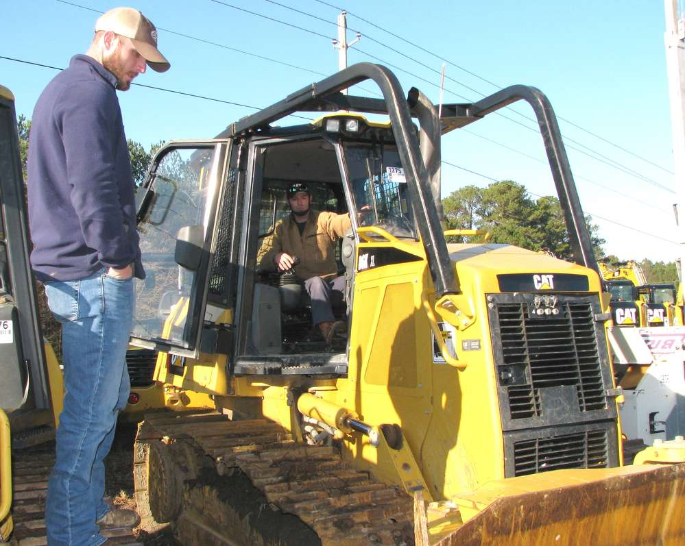 Jason Heyman (L) of Baldpates Foundation & Construction, Jersey, Ga., and Casey Leftwich of Big Case Unlimited, Stockbridge, Ga., inspect this Cat D6K XL dozer.
