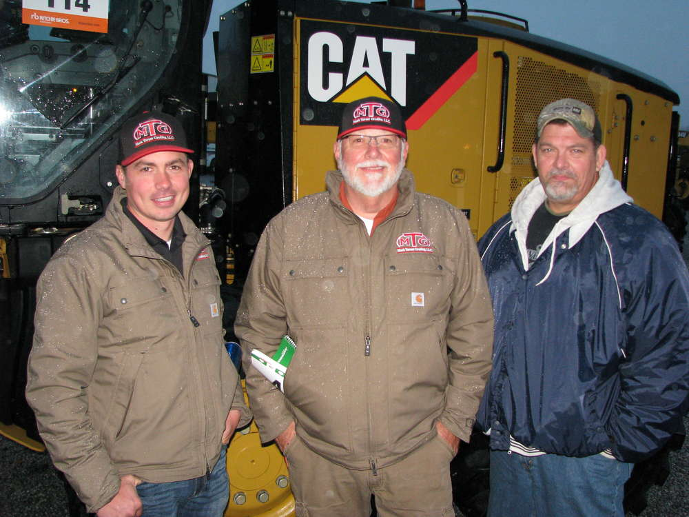 (L-R): Harvey Crowe, Mark Turner and Tim Harkins, all of Mark Turner Grading, based in McDonough, Ga., shop the selection of equipment at the auction.