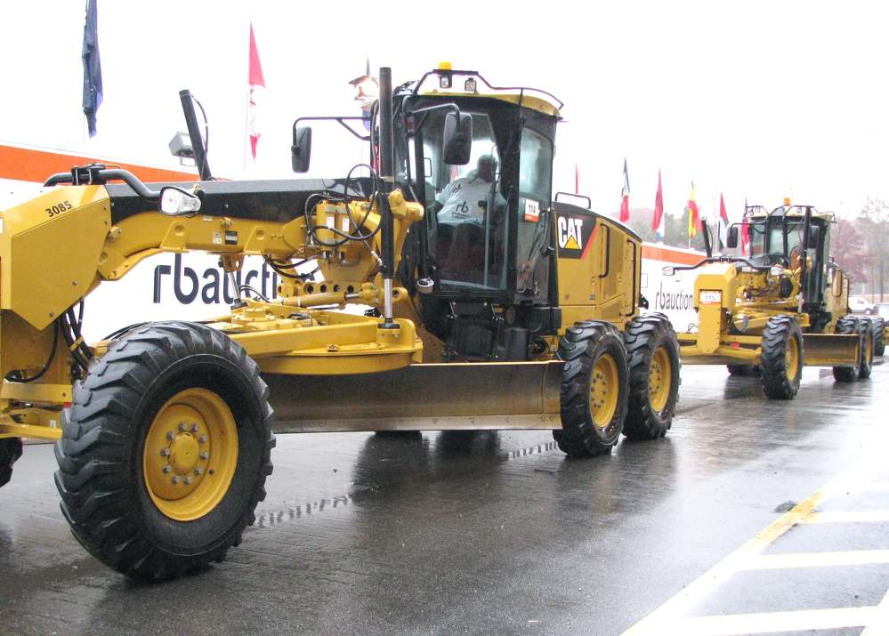 The highest bid on this 140M Cat motorgrader was $107,500, and the bidder decided to take both 140Ms that rolled across the ramp.