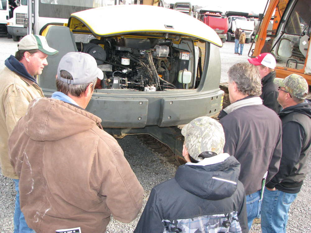 Attendees inspect the equipment before placing a bid.