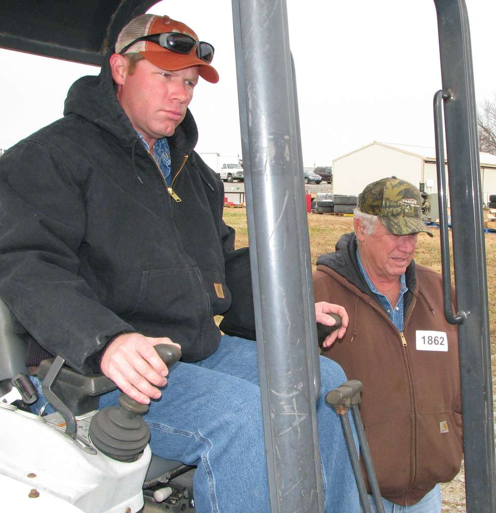 Gregory (L) and Johnny Ward of Ward Construction, Linden, Tenn., operate a  Bobcat mini-excavator.