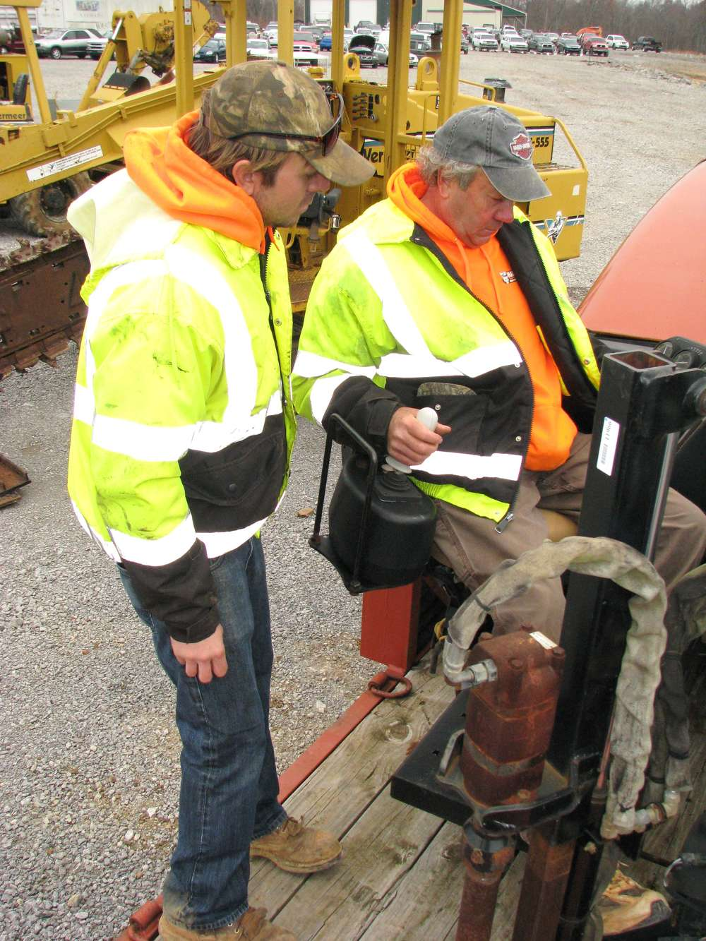 Keaton (L) and C.K. Hanks, both of Hanks Directional, Auburn, Ky., test this Ditch Witch JT2020 directional drill.