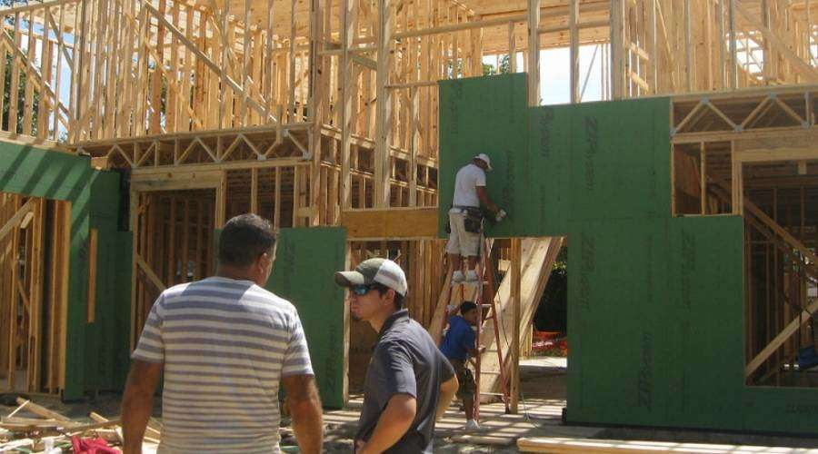 Jesse Johnson, (wearing hat), a student in construction management, at the Preston Hollow home job site.