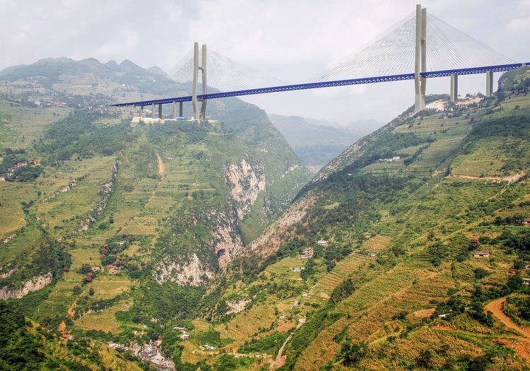 The bridge was designed to shorten the distance between Xuanwei and Shuicheng County, a journey which, by car, takes over four hours.