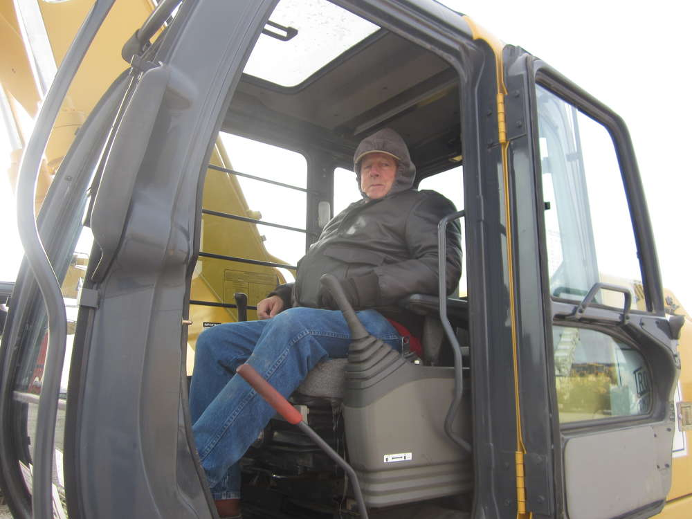 Les Hull, owner of Hulls 151 Implement, fires up this John Deere 200C excavator.