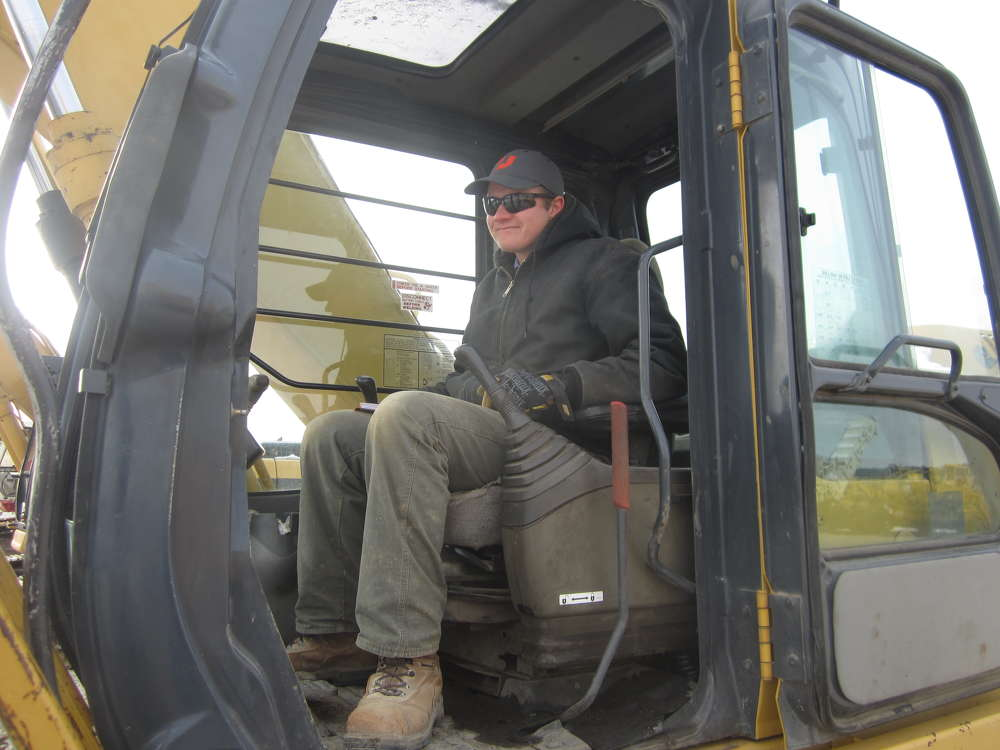 Isaac of Isaac Construction tests out this John Deere 200C excavator.