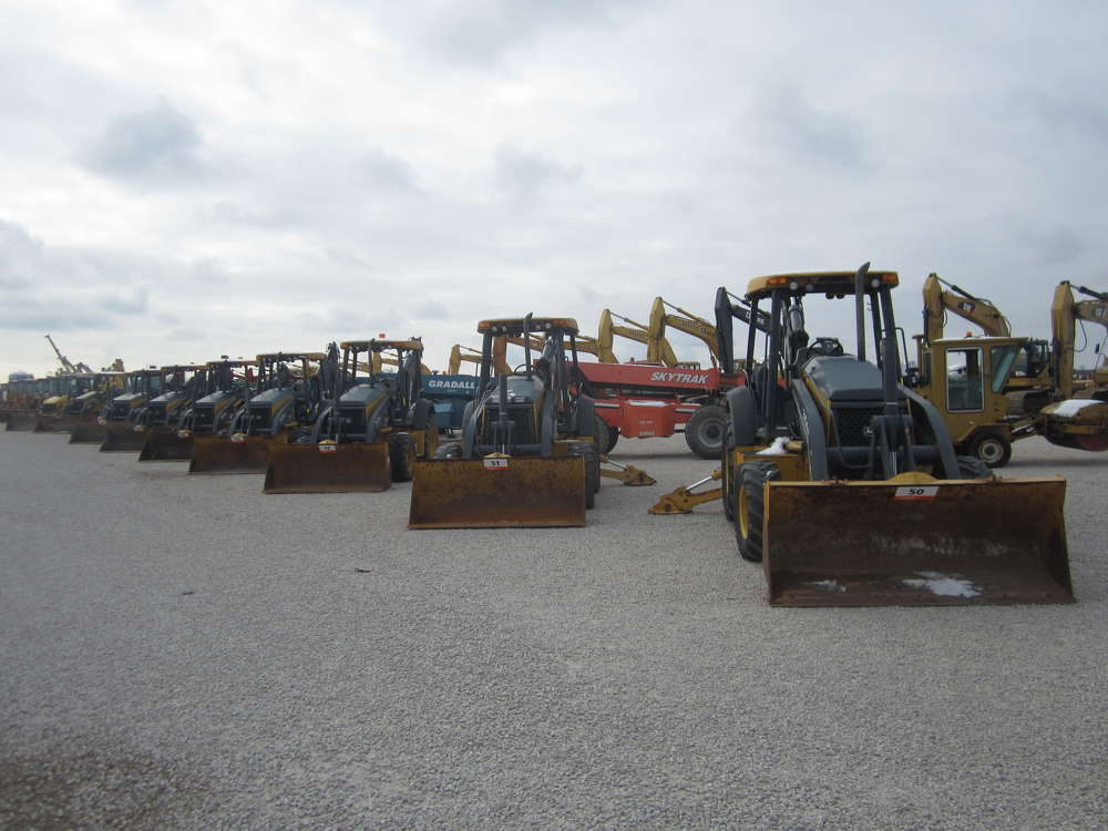 More than 1,700 equipment items and trucks were sold in the auction, including these John Deere backhoes.