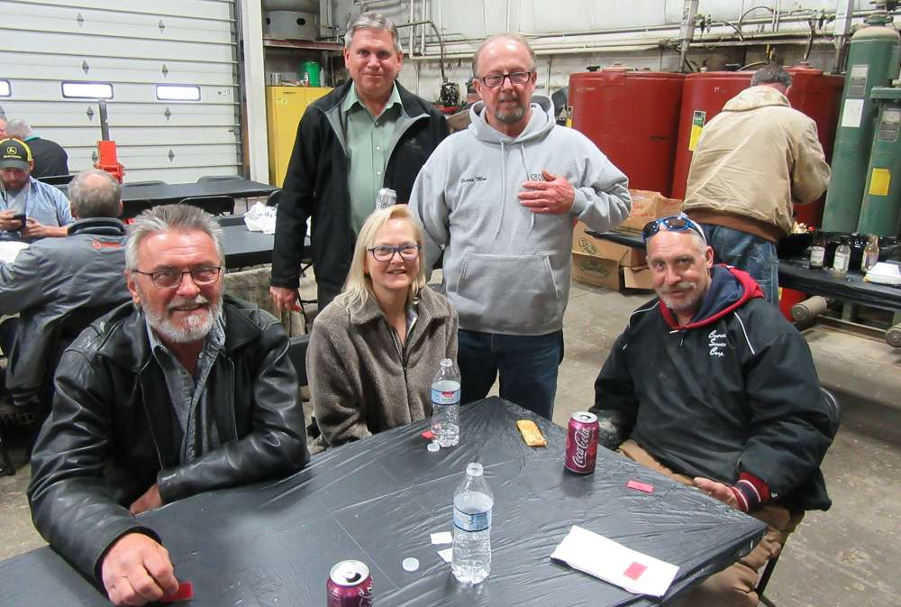 (L-R): Peter Nadhazy and Jill Drensky, J&P Excavating, enjoy lunch with Chuck Ruggles, Murphy Tractor & Equipment Company;  Clarence Stockdale of Buggy Man; and Mike Potoma of Concrete Service Corp.