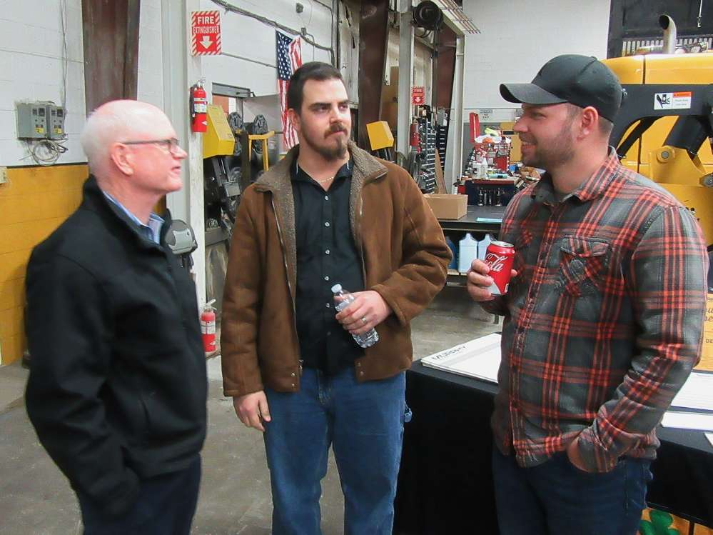 (L-R): Mike Slinger, Murphy Tractor & Equipment Company, catches up with Neil and Mike Switzer, both of Independence Excavating, at the Brunswick branch.