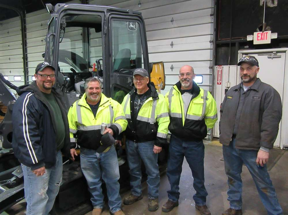 (L-R): Bob Weingart, Jerry Kinsley, Jim Reid and Steve Velopotosky, all of Stark County Engineers, talk with Matt Price, Murphy Tractor & Equipment Company, at the Canton branch open house.
