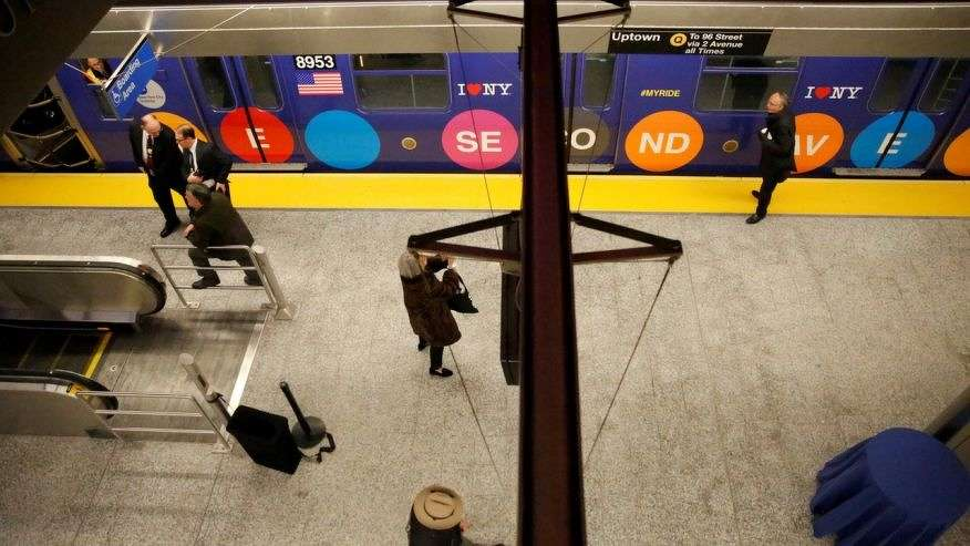 Subway goers walk on the platform at the celebration for the completion of the Second Avenue Subway with New Year's Eve inaugural ride in Manhattan, New York City, U.S., December 31, 2016.  (REUTERS/Elizabeth Shafiroff