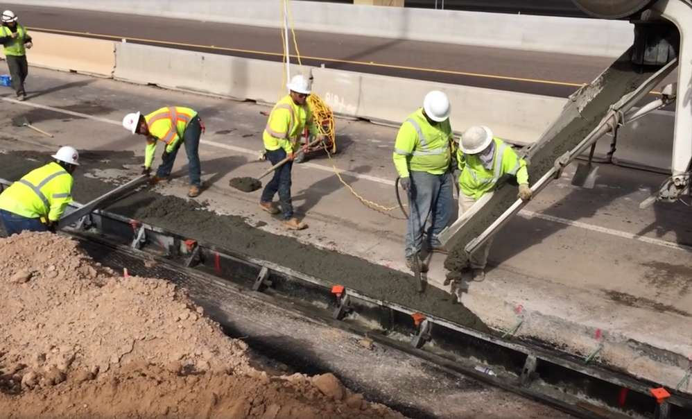 Crews begin pouring concrete to widen Pecos Road for the South Mountain Freeway project.