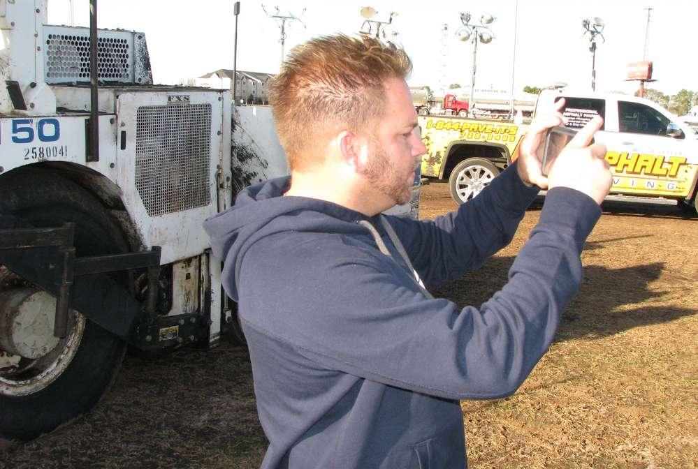 Willie Jeffery of Willie Jeffery Asphalt Paving Alma, Ga., takes pictures of paving equipment he plans to bid on.
