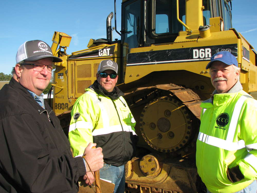 (L-R): Bill Jones, Ben Coggins and Kenny Coggins, all of Coggins Construction Company, Thomaston, Ga., inspect the equipment at the auction.