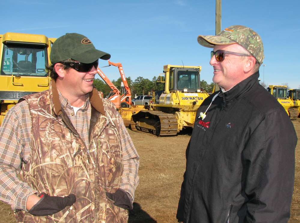 Tom Powell (L) of LowBird Outdoors and Duncan Hunt of Duncan Machinery attend the auction.