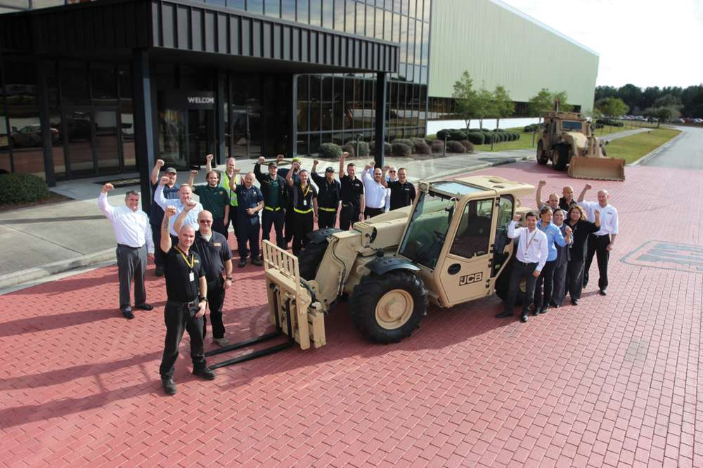 Employees at JCB's North American HQ celebrate news of the $142-million U.S. Army order.