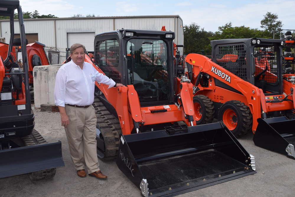 John Eighmy, general manager of the Florida Coast Equipment Naples, Fla., location, stands in front of this Kubota SVL 75-2 track loader.