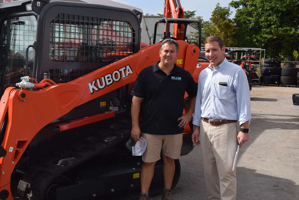 Tim Felts (L) of Blue Landscaping and Todd Bachman, president of Florida Coast Equipment, stand in front of this new Kubota track loader.