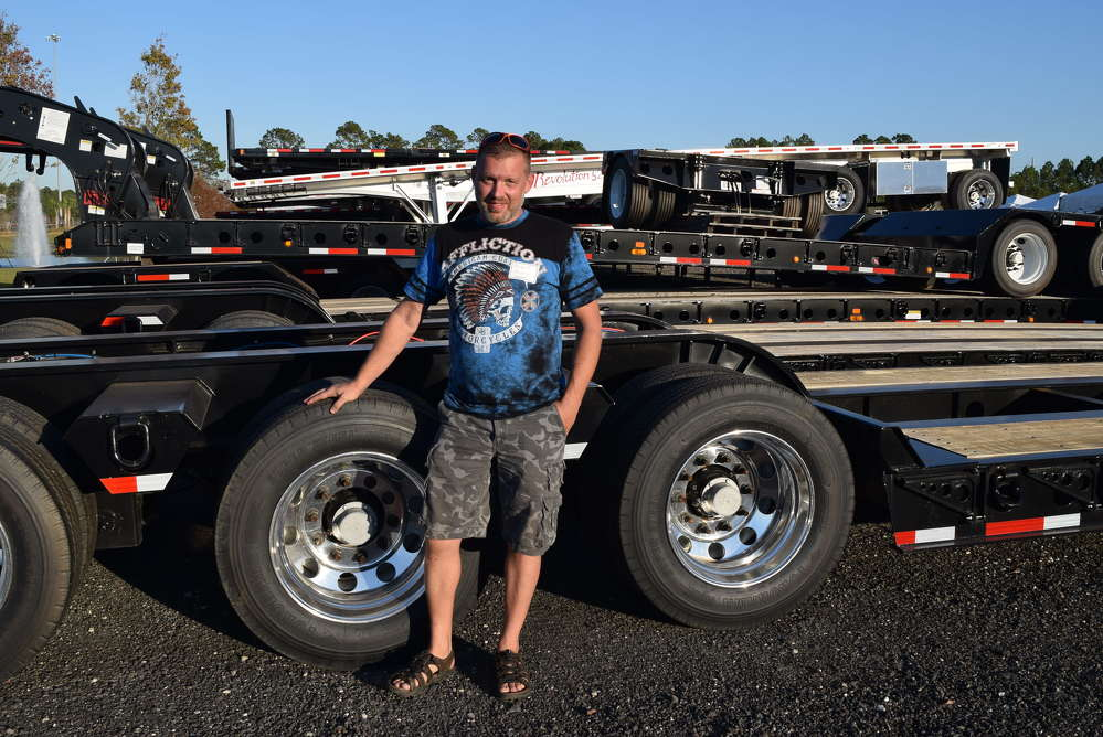 Brent Moore of Landstar based in Jacksonville, Fla., checks out the features and benefits of this new lowboy trailer.