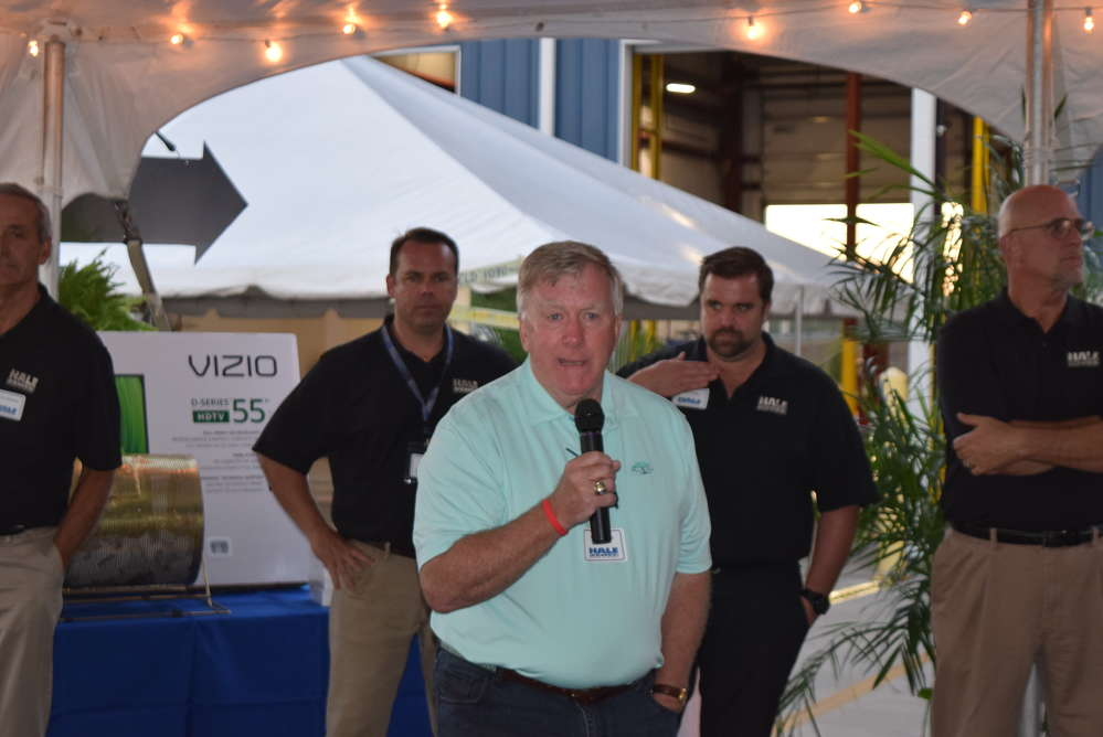 Barry Hale, founder and president of Hale Trailer, addresses the crowd at the open house.