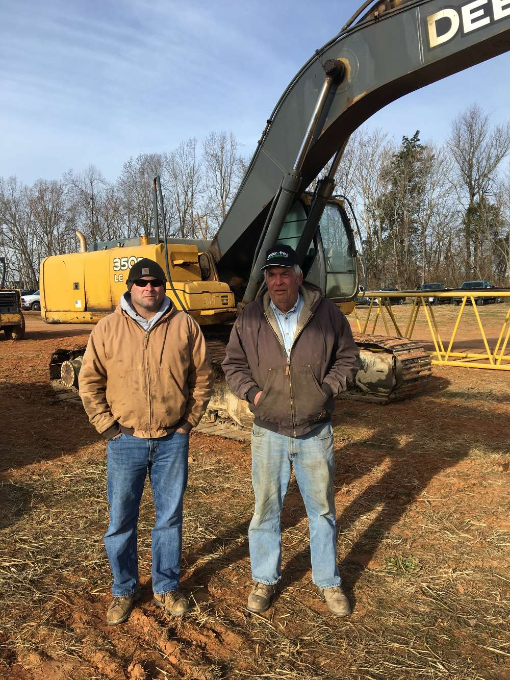 Chad Martin (L) and Kent Coble, both of Coble Sandrock in Libery, N.C., look for an excavator for an upcoming project.
