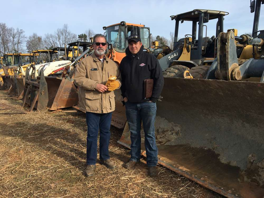 Walter Boring (L) of Boring & Associates Construction Equipment in Ocala, Fla., and Rusty Moss of MAG Enterprises in Blacksburg, S.C., shop the selection of equipment.
