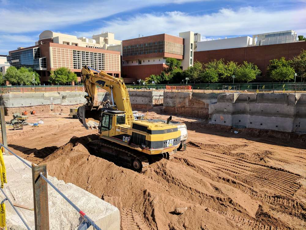 Initial work on the facility includes excavation and shoring. Concrete caissons are complete.