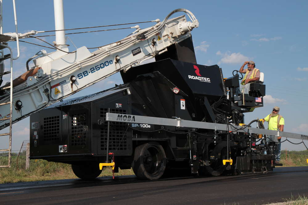 The paver works in tandem with a Roadtec SB-2500e Shuttle Buggy material transfer vehicle (MTV), which provides a steady flow of HMA to the paver.