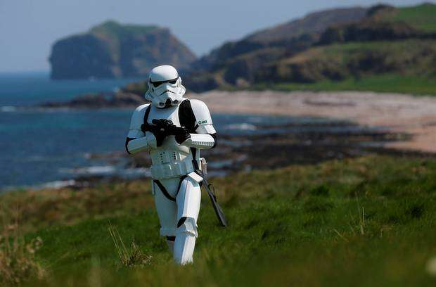 Local Star Wars fan, JJ McGettigan, poses in Malin Head. PA http://url.ie/11nnn