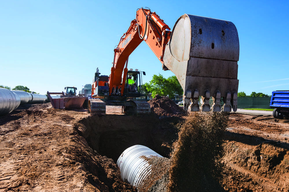 The Hitachi excavators have moved about 75,000 cu. yds. (57,342 cu m) of material to install over 4 mi. (6.4 km) of pipe for sewer, water and a storm water underground storage system