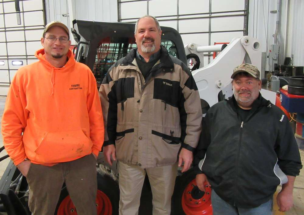 (L-R): Joe Fiore and John Johnson, both of Fiore Contracting, talk with Tim Cannon, Bobcat Enterprises, at the Reynoldsburg open house event.