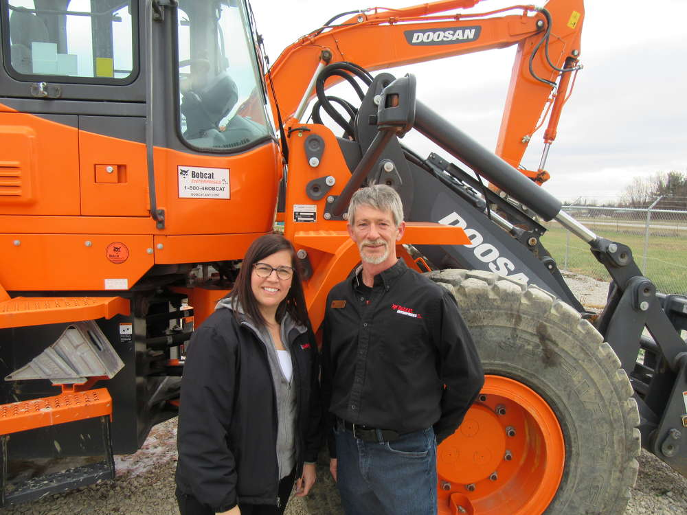 Kimberly Trapp, Bobcat Enterprises general manager,  joins Kevin Eavers, Reynoldsburg branch manager, to showcase the dealership's lineup of Doosan machines