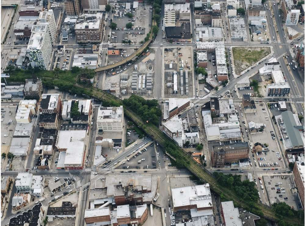 bird's-eye view of the overgrown elevated rail track.