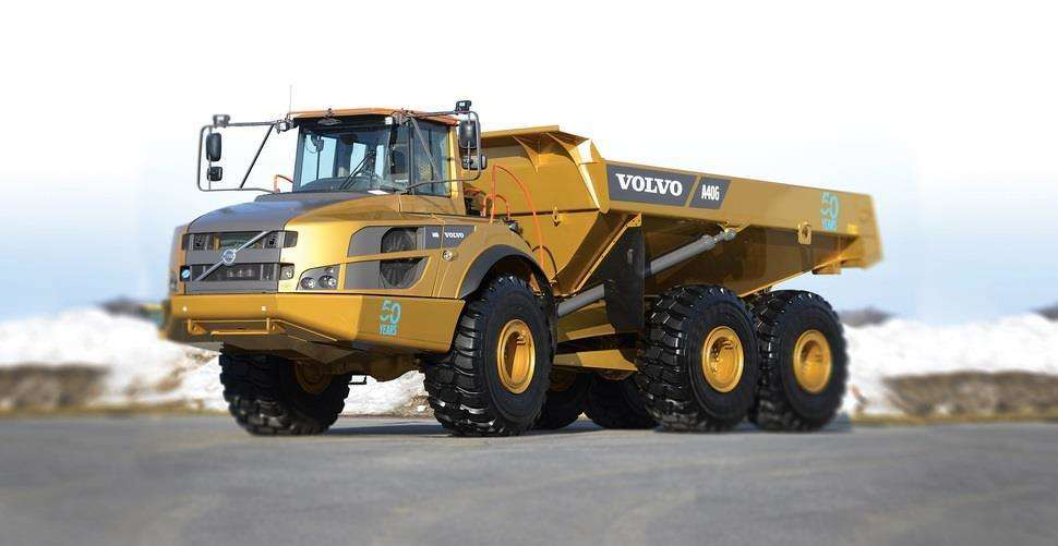 Gold-painted Volvo A40G articulated hauler.