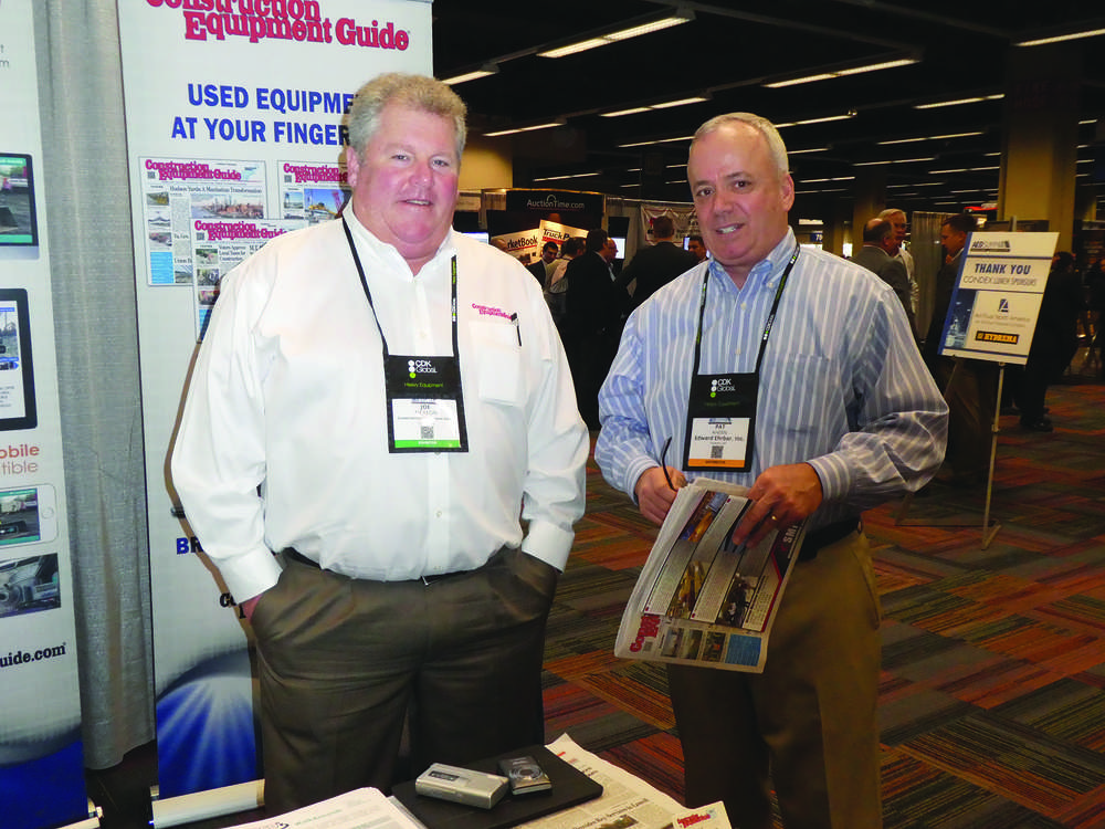 Stopping by the Construction Equipment Guide booth and visiting with Joe McKeon (L) at the recent AED Summit in Chicago is Patrick Ahern (R) of Edward Ehrbar corporate headquarters, Yonkers, N.Y.