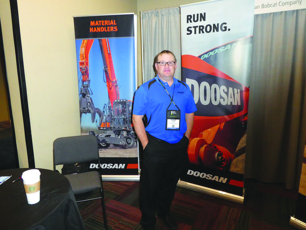 Handling booth duty for Doosan Infracore Construction Equipment America is Chad Roehrich.